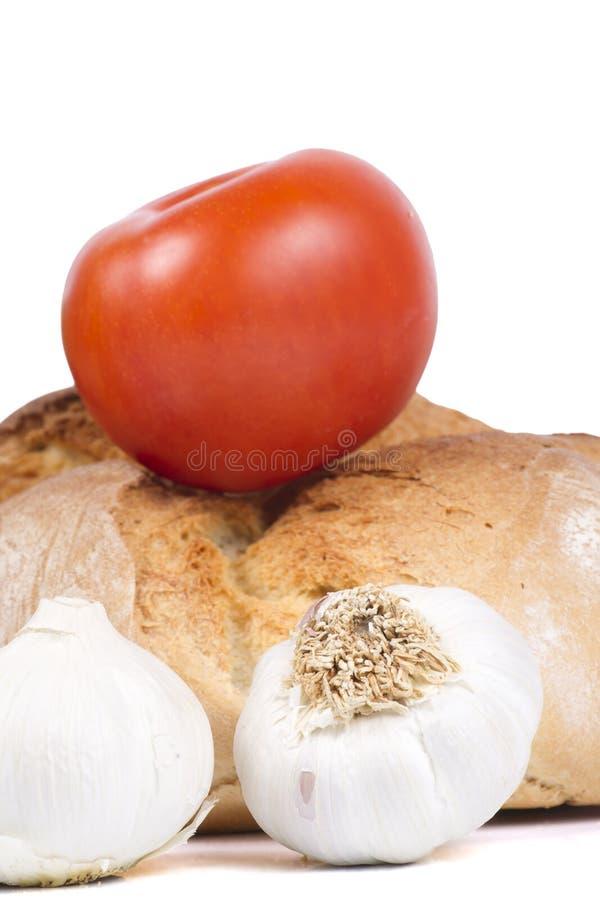 Frisches Brot mit Tomatoe und Knoblauch stockfotos