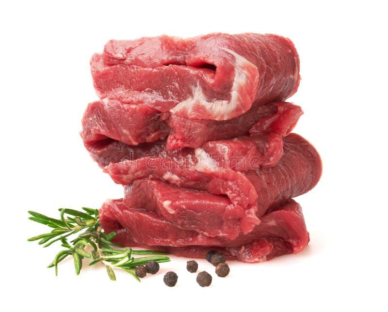 Frisches rohes Fleisch mit Pfeffer und Rosmarin lizenzfreie stockbilder