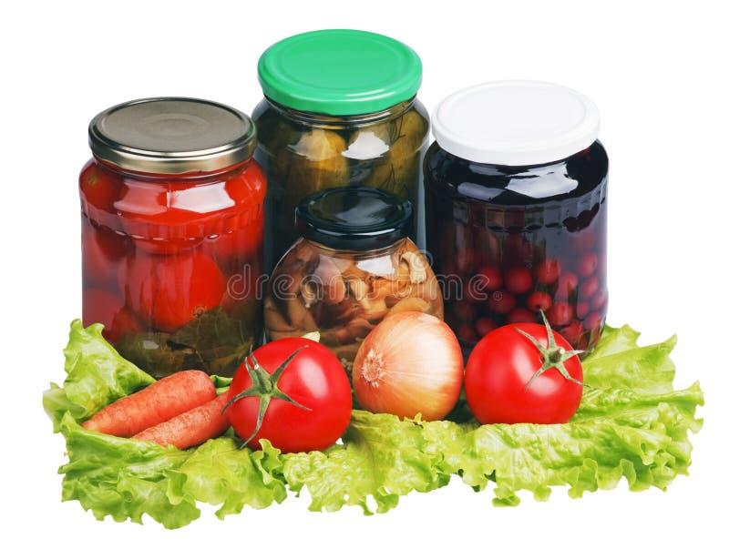 Frisches und konserviertes Gemüse stockfotografie