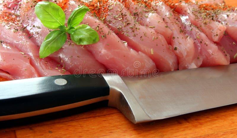 Frischfleisch mit Messer stockbilder