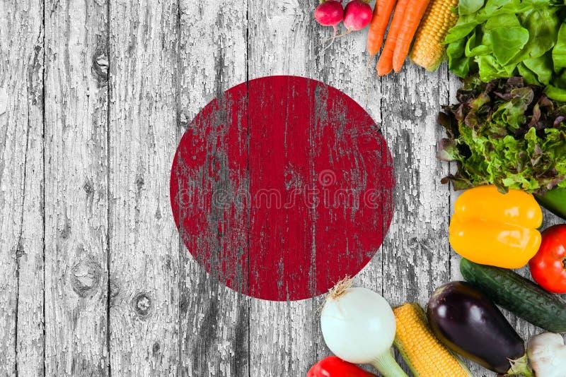 Frischgem?se von Japan auf Tabelle Kochen des Konzeptes auf h?lzernem Flaggenhintergrund stockbild