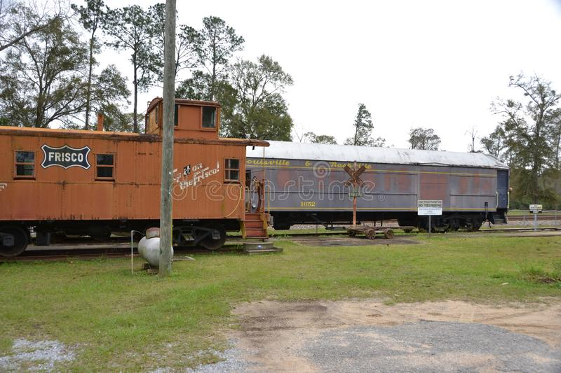 Railroad museum with a Frisco boxcar and L&N car. Frisco boxcar, old L&N train car, museum pieces, visitor oriented, transportation memory or memories royalty free stock photo