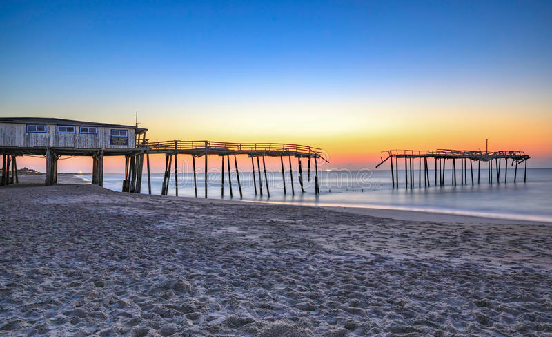 Frisco North Carolina Fishing Pier. The Frisco Fishing Pier in North Carolina on the Outer Banks is damaged and scheduled for demolition stock photo