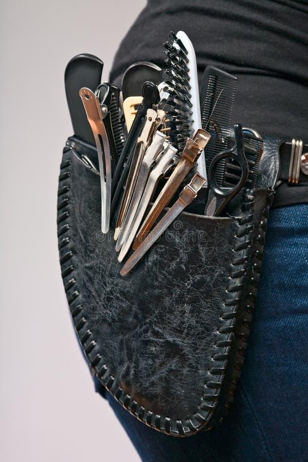 Friseur mit Ausrüstungspistolenhalfter lizenzfreies stockbild