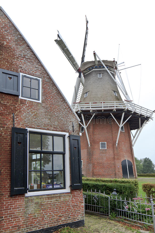 Frisian smock mill Zeldenrust in Dokkum, Holland. Zeldenrust or in English Seldom at rest, a smock mill in the dutch town of Dokkum, was built in 1862 and is stock images
