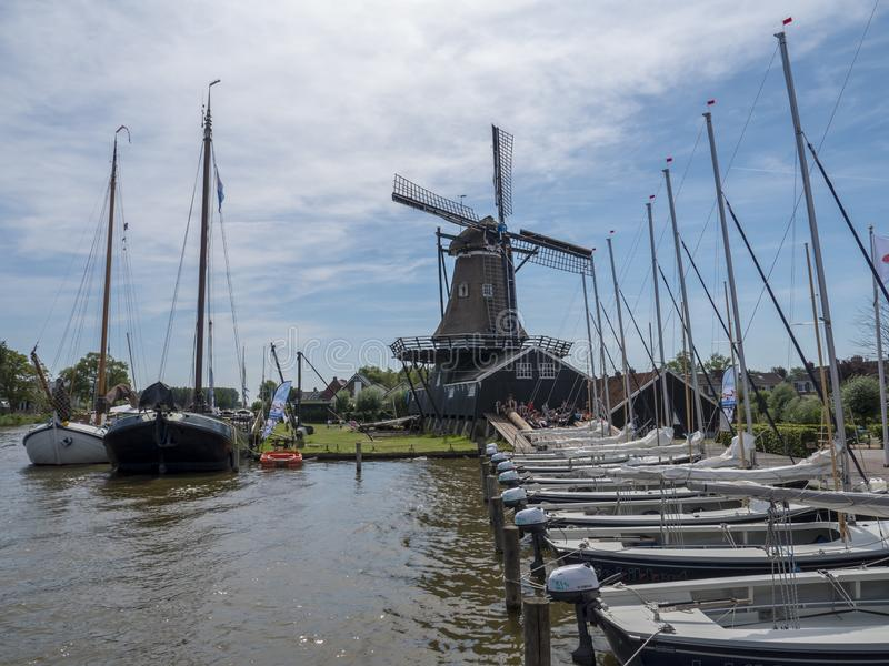 In the Frisian water sports village Woudsend many sailing boats are ready for a sailing camp stock photography