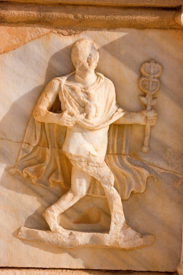 Friso esculpido con un hombre, Sabratah - Libia imagenes de archivo