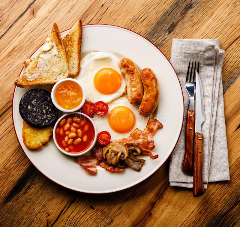 Fritada completa acima do café da manhã inglês com ovos fritos, salsichas, bacon foto de stock