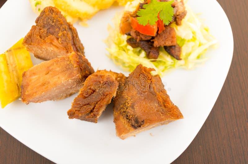 Fritada frió la comida tradicional del ecuadorian del cerdo foto de archivo