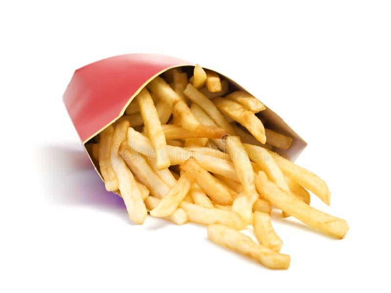 Fritadas do francês do fast food que caem da caixa fotografia de stock