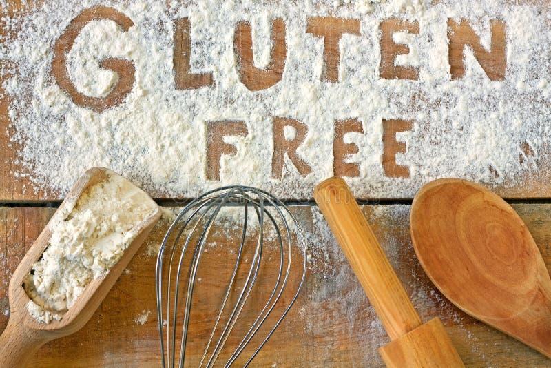 Fritt ord för gluten med wood bakgrund arkivfoto