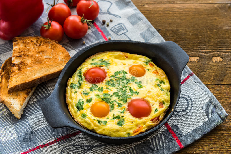 Frittata (italian omelet) with paprika and cherriy tomatoes. View from above. royalty free stock photos