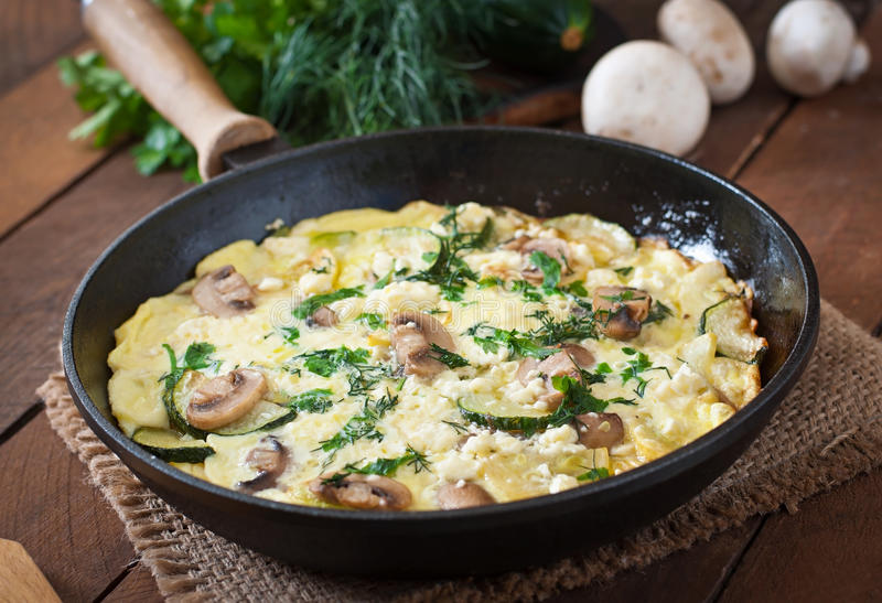 Frittata. With mushrooms, zucchini and cheese royalty free stock image