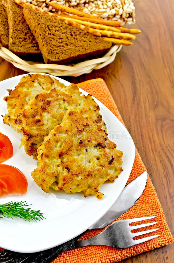 Fritters chicken with bread on the board stock images