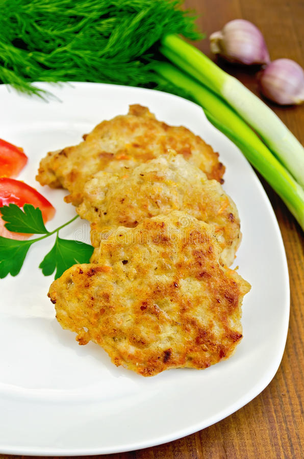 Fritters chicken with vegetables on the board stock images