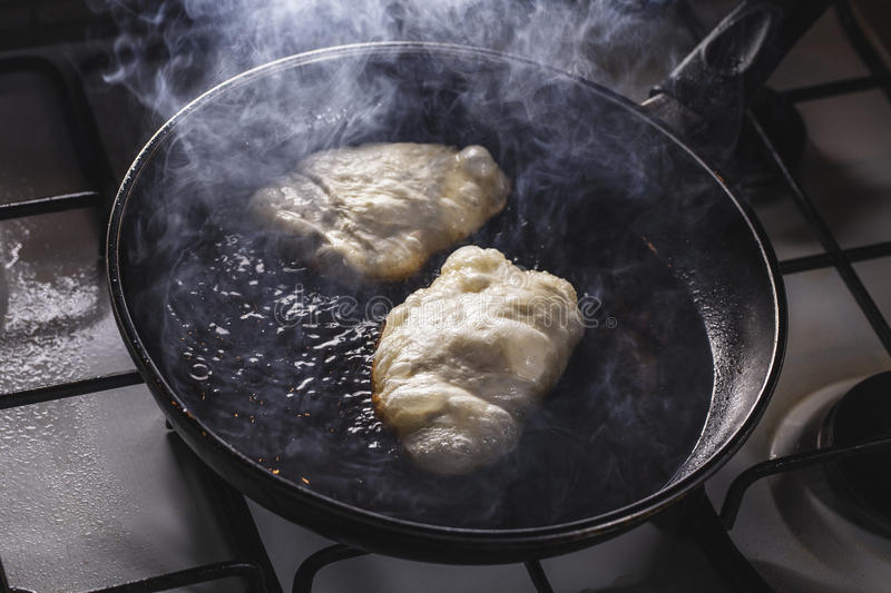 Fritters fry on frying pan stock images