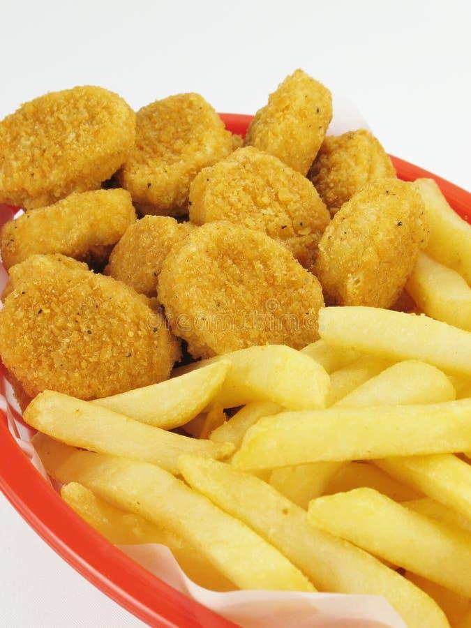Fritures et pépites de poulet images stock