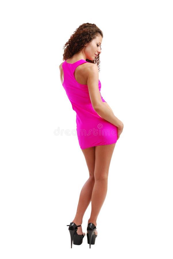 Frizzy kobieta w świetlicowej sukni zdjęcie royalty free