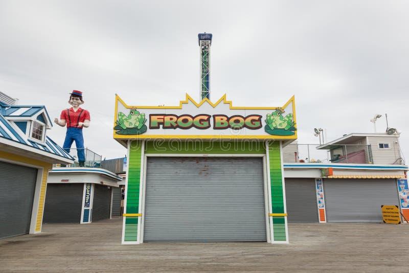 Frog Bog Boardwalk Game. SEASIDE HEIGHTS, NEW JERSEY - March 21, 2017: The Frog Bog boardwalk game is closed for the season stock photos