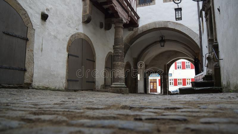 Frog perspective of old medieval street in town center royalty free stock image