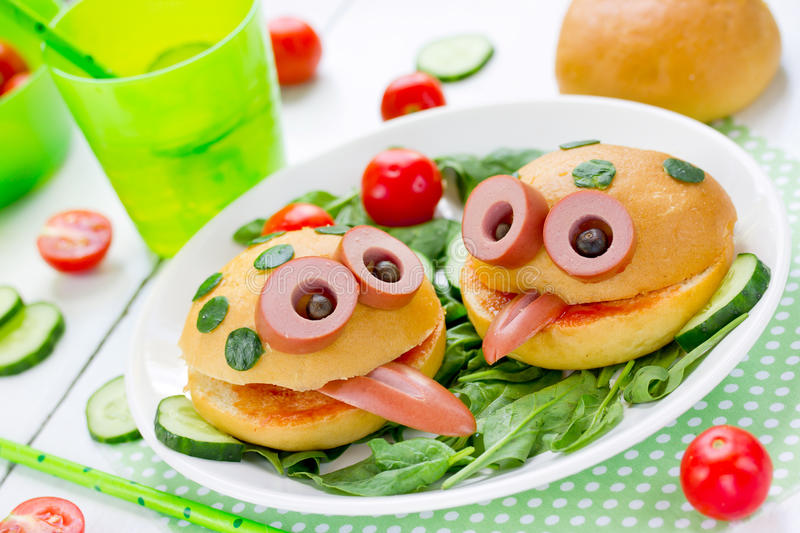 Frog sandwich - creative idea for kids lunch. Fun animal burger shaped frog stock image