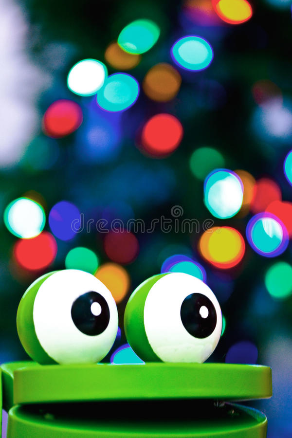 Frog toy with Christmas Lights. This child's toy was bright and bold and already positioned in front of the Christmas tree for me to take pictures royalty free stock image