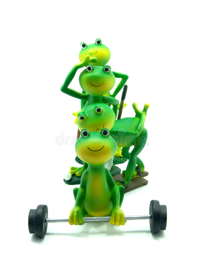 Sportive miniature frog figurines royalty free stock images