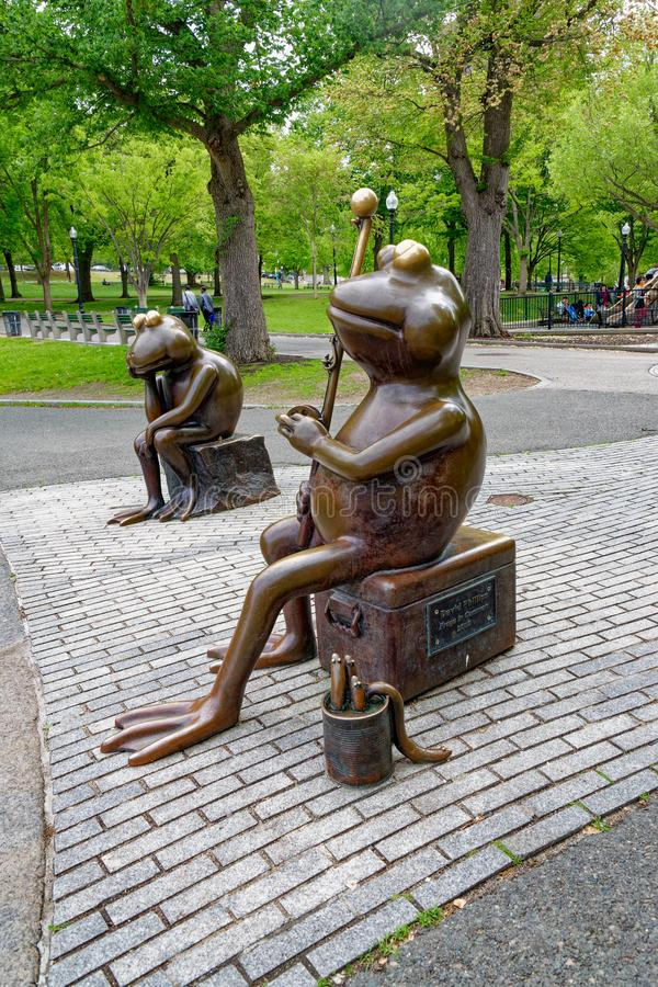 `Frogs in Common` a bronze sculpture. Boston, MA - May 20, 2015: `Frogs in Common` a bronze sculpture by David Phillips sits between the Frog Pond and Tadpole royalty free stock photos