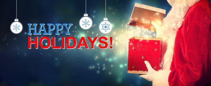 Frohe Feiertage Mitteilung mit Sankt, die eine Geschenkbox öffnet lizenzfreie stockfotos