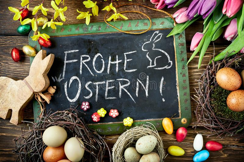 Frohe Ostern Easter greeting with eggs and flowers stock images