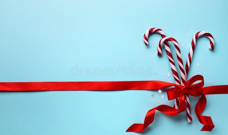 Frohe Weihnacht-Gruß-Karte; Weihnachtszuckerstange lizenzfreies stockbild