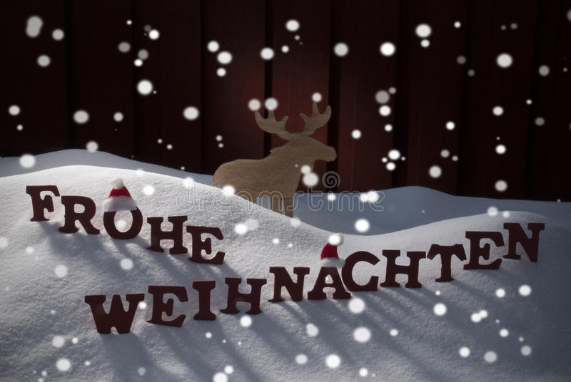 Frohe Weihnachten Means Merry Christmas Moose. Red Letters Building German Word Frohe Weihnachten Means Merry Christmas As Decoration Card. Snow And Snowy stock photography