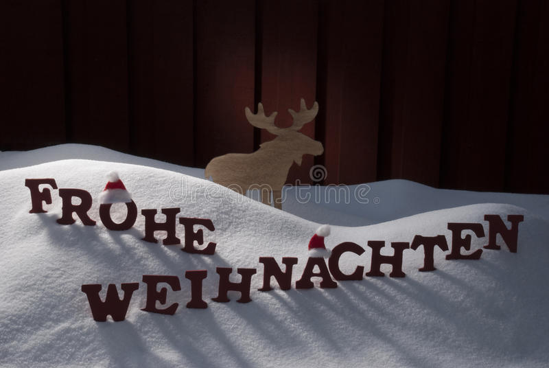 Frohe Weihnachten Means Merry Christmas Moose Snow. Red Letters Building German Word Frohe Weihnachten Means Merry Christmas.Decoration Card For Seasons stock photos