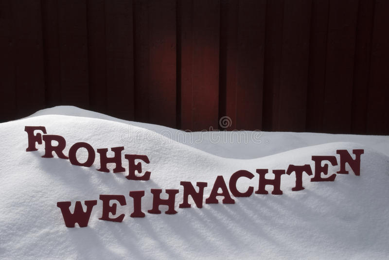 Frohe Weihnachten Means Merry Christmas On Snow. Red Letters Building German Word Frohe Weihnachten Means Merry Christmas. Decoration Card For Seasons Greetings royalty free stock photos