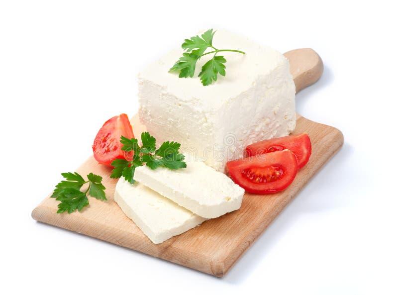 Fromage bulgare blanc, disposé avec des tomates images libres de droits