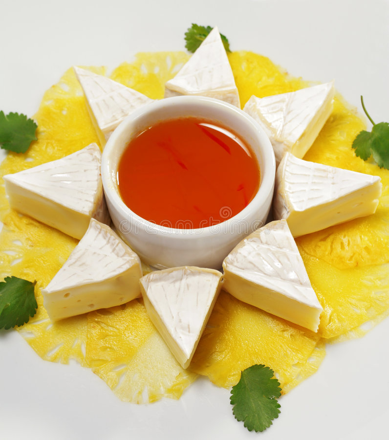 Fromage with Honey Orange Sauce. Fromage (Soft Cheese) with Honey Orange Sauce and Fresh Thin Pineapple stock image