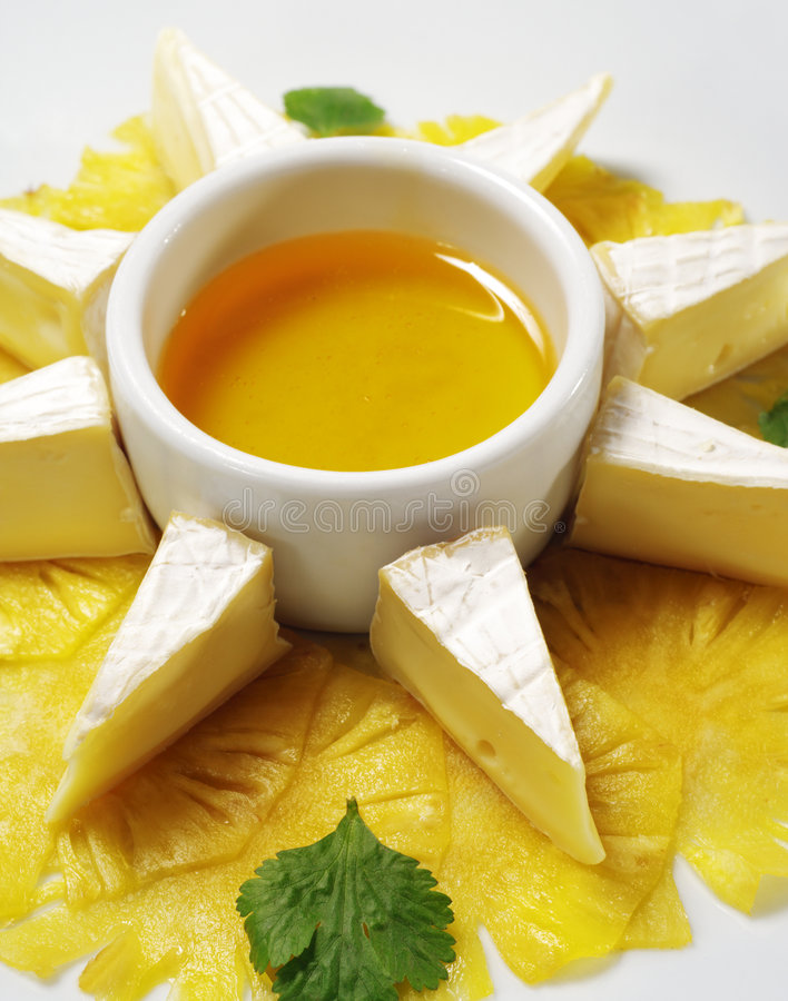 Fromage with Honey Sauce. Fromage (Soft Cheese) with Honey Sauce and Fresh Pineapple stock images