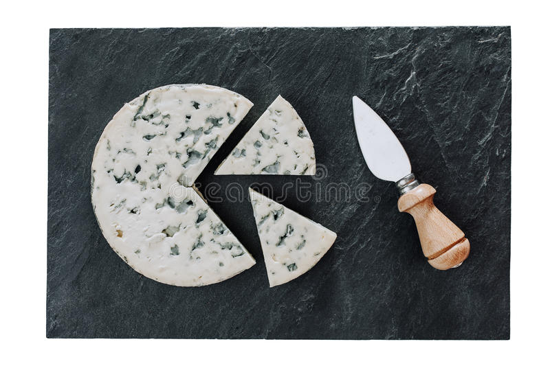 Fromage rond avec le couteau image stock
