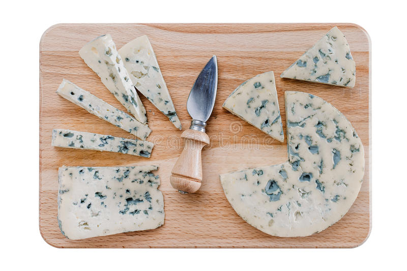 Fromages sur le conseil cutiing photographie stock