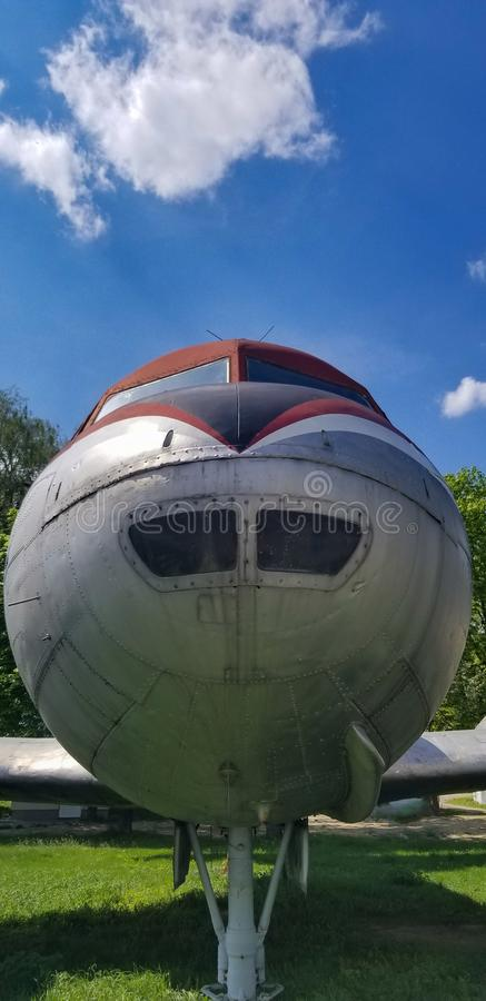 Fron view of airplane. Nose cone with blue sky. wide angle vertical shot stock photos