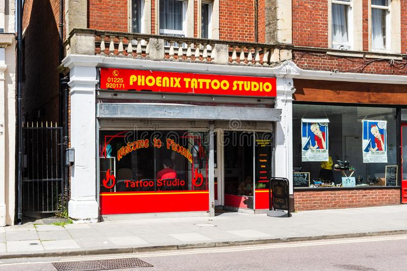 Trowbridge Wiltshire June 28th 2019 The front of the Phoenix tattoo studio shop. The fron window of the Phoenix tattoo studio shop in Trowbridge Wiltshire with stock image