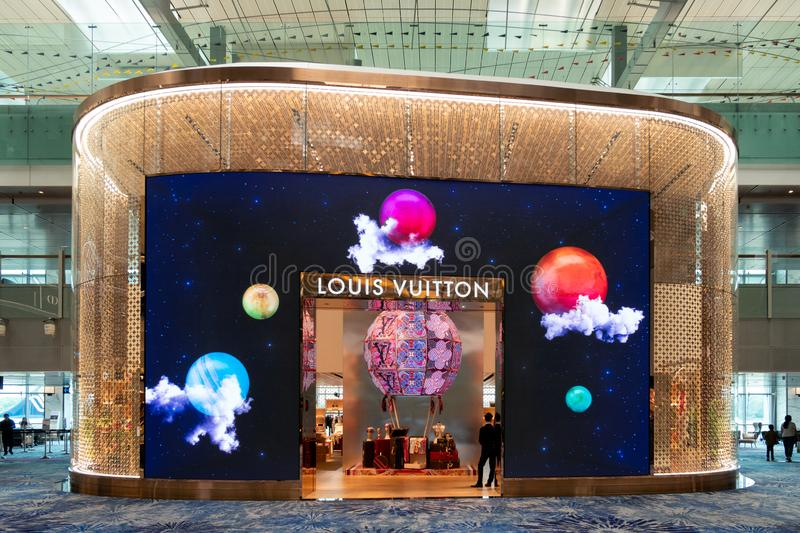 Front architecture of store brand louis vuitton design with light illumination design. brand about of fashion, bag, accessories. Changi, Singapore - Sep 08 2018 royalty free stock photography