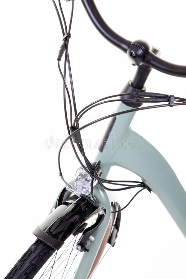 Front bike detail and wheel of a road bicycle on white background isolated royalty free stock images