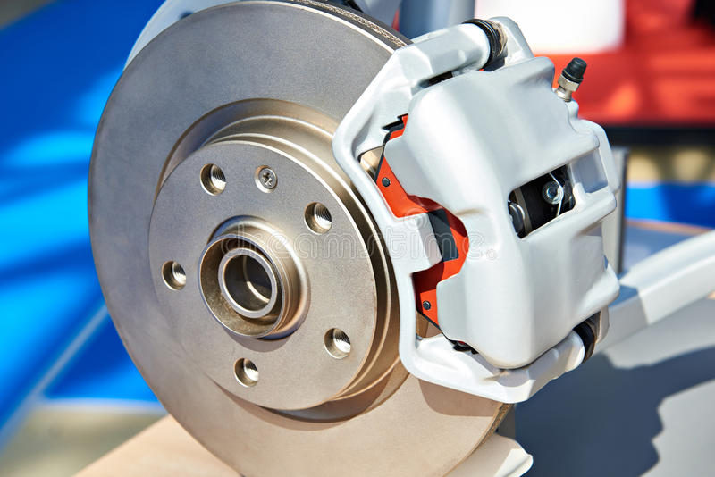 Front caliper and brake disc. Closeup royalty free stock images