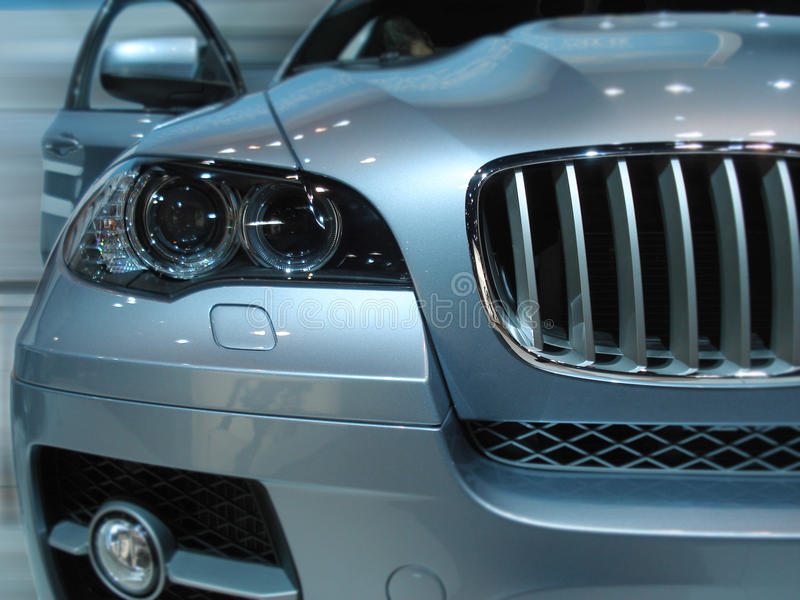 Front of a car. Front side of a car with blurred background stock image