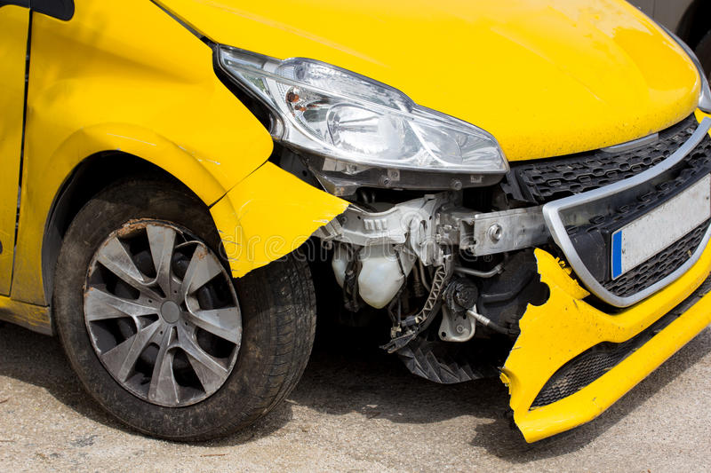 Front Car Damage After Accident. Yellow Car Front Damage After Accident stock photo