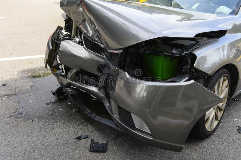 Front of car get damaged by accident on the road royalty free stock image
