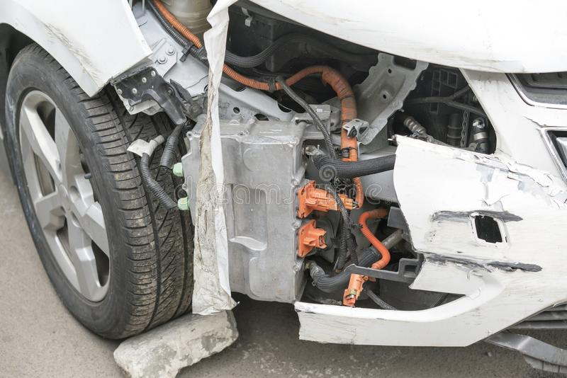 Front of car get damaged by accident on the road. Car crash accident on street, damaged automobiles after collision . stock photo