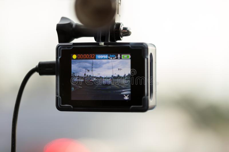Front CCTV car camera video recorder for safety on the road with royalty free stock photography