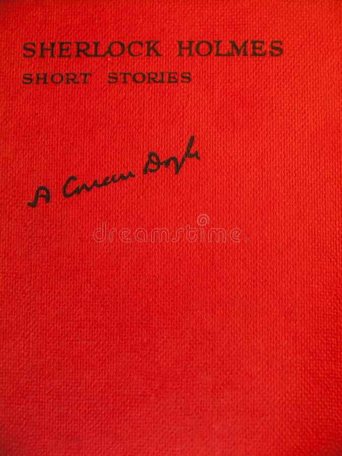 Front cover of aged of sherlock holmes short stories. Red front cover of aged of volume of sherlock holmes stories carrying the title sherlock holmes short stock photo